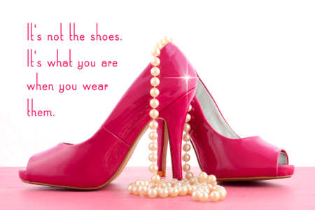 quotation: High Heel Shoe with cute inspiration and funny quotation on pink wood table.
