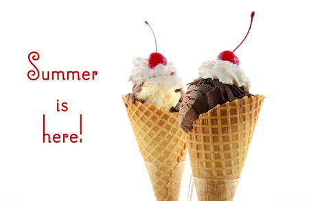 Summer concept chocolate and vanilla ice cream wafer cone with whipped cream and cherry with stem on top, with Summer Is Here text