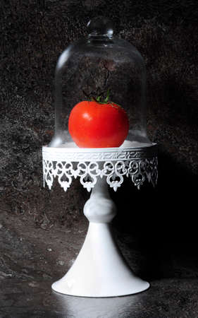 kitchen bench: The Humble Tomato in vintage cake stand against dark slate kitchen bench top.