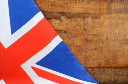 union flag: Great Britain UK Union Jack Flag against dark distressed recycled wood background. Stock Photo