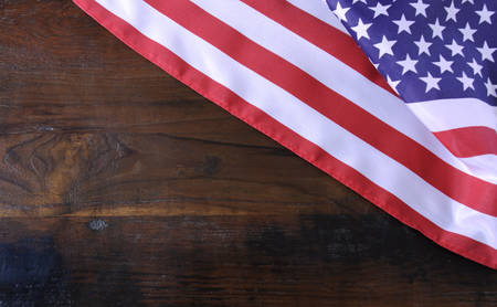 independance: USA American stars and stripes flag on dark reclaimed wood background with copy space.