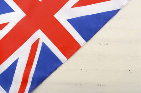 union: British Union Jack Flag on white wood shabby chic table with copy space for your text here.