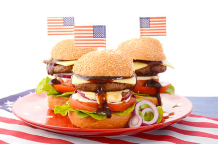 independance: The Great BBQ Hamburger with American flags for USA Fourth of July and holiday events party celebrations. Stock Photo