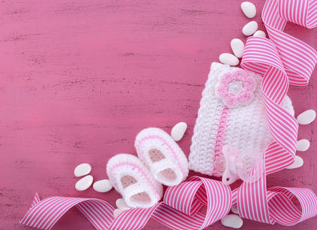 Its a Girl Baby Shower or Nursery background with baby clothes and accessories with copy space for your text here. Standard-Bild