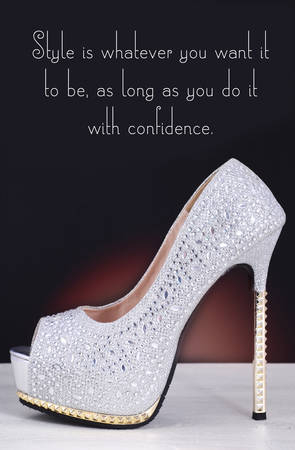 High heel silver with rhinestone stiletto shoe with Style is Whatever You Want quote, on white wood table and black background.