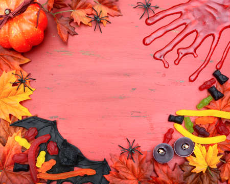 gory: Halloween rustic red wood background with bloody hand prints and decorations, with copy space for your text here.