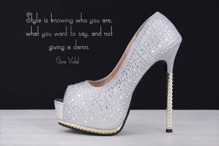 rhinestone: High heel silver with rhinestone stiletto shoe with Style Is Knowing Who You Are quote, on white wood table and black background.