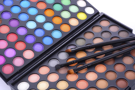 color color palette: Professional artists makeup eye shadow palette with bright and autumn brown color range. Stock Photo