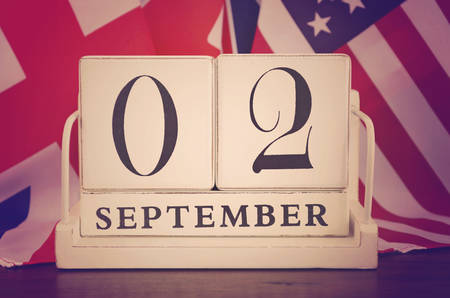 vj: End of WWII 2 September 1945 Calendar Date with group of flags, and applied retro vintage style filters. Stock Photo