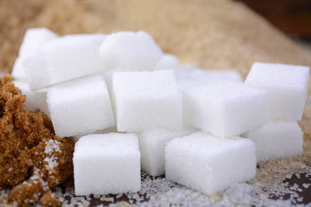 sugar cubes: Different types of sugar including white, brown, dark brown, demerara, coffee sugar crystals and sugar cubes.