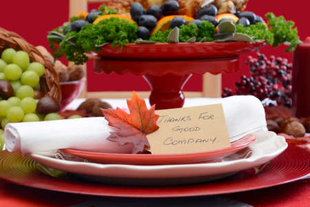 fine cane: Red and white theme Thanksgiving Table setting with Roast Turkey Chicken on large platter centerpiece closeup on Thanks For Good Company place setting.