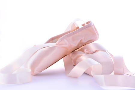 training shoes: Pointe Ballet Shoes on white background. Stock Photo