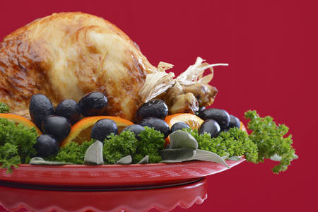 centerpiece: Red and white theme Thanksgiving Table setting with Roast Turkey Chicken on large platter centerpiece. Stock Photo
