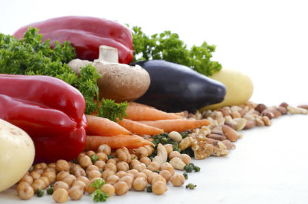 prebiotic: Vegetarian food including vegetables, nuts and legumes with copy space on white background. Stock Photo