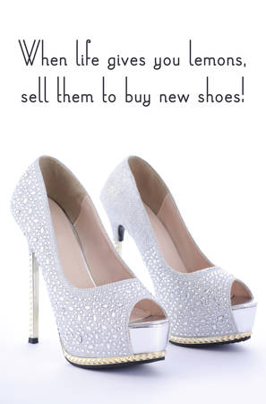 rhinestone: High Heel Rhinestone Shoes with Funny Saying Text, When life gives you lemons sell them to buy new shoes, on white background.