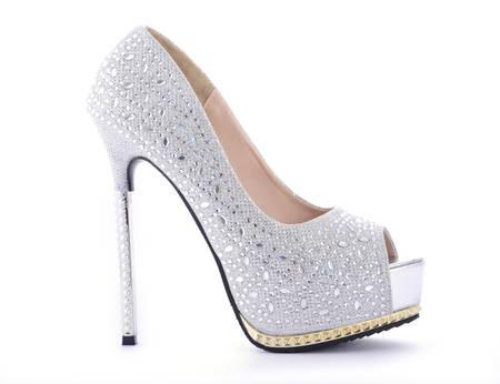shoes: Rhinestone high heel stileto shoe on white background. Stock Photo