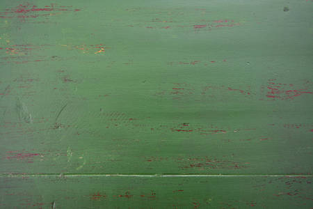 distressed: Dark green rustic distressed on reclaimed wood background for Christmas or festive backgrounds.