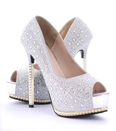 rhinestone: Pair of rhinestone high heel stiletto shoes on white background. Stock Photo