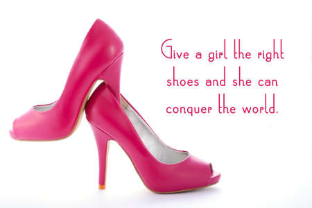 conquer: Pair of high heel stiletto pink shoes with, give a girl the right shoes and she can conquer the world, quote on white background. Stock Photo