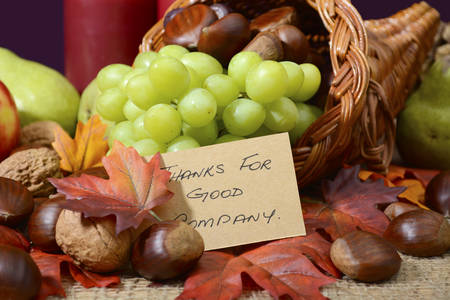 Country style rustic Thanksgiving table setting closeup on cornucopia with Thanks for Good Company message.