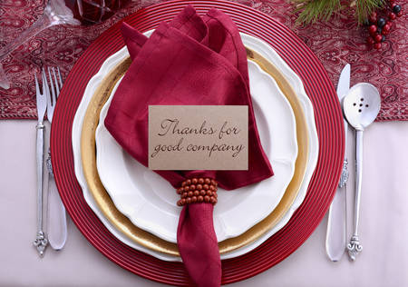 dinner party: Traditional red theme festive table place setting for Thanksgiving dinner party table. Stock Photo