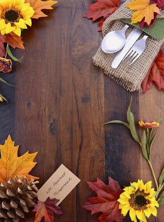 setting: Happy Thanksgiving dark wood background with decorated borders. Stock Photo