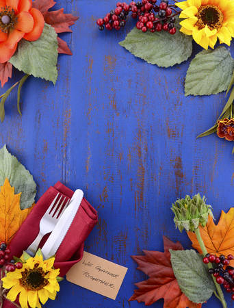 background settings: Happy Thanksgiving dark blue wood background with decorated borders of sunflowers and place settings.