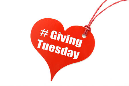 Giving Tuesday red heart shape ticket, with sample text on white background. 免版税图像