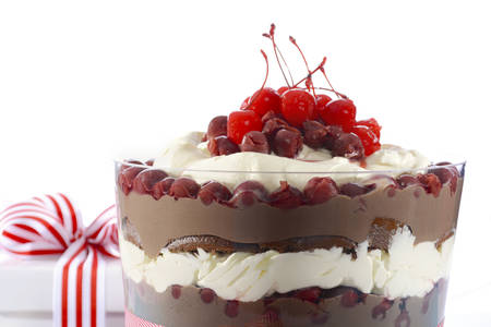 trifle: Black Forest Trifle Dessert with layers of chocolate cake, chocolate custard, sour cherries, and whipped cream in festive setting. Stock Photo