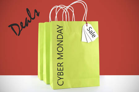 christmas savings: Lime green shopping bag on red and white background for Cyber Monday sales with sample text.