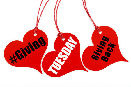 Giving Tuesday red heart shape ticket, with sample text on white background. Stock Photo