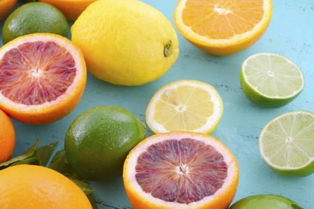 aqua: Citrus Fruit on vintage aqua distressed wood table, including navel and blood oranges, lemons and limes.