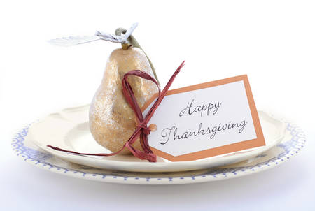 place card: Elegantblue and white theme Happy Thanksgiving table place setting with gold and silver pear ornament. Stock Photo