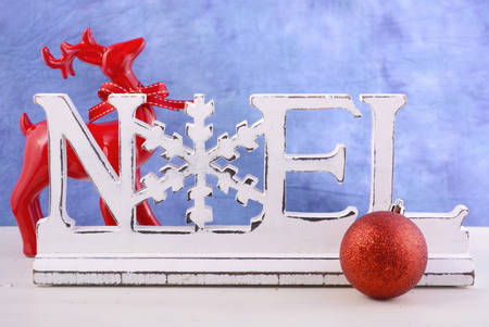 mantel: Modern Christmas mantel decorations with wooden Noel word against a blue and white background.