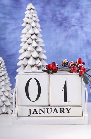january 1: Happy New Year vintage wood block calendar for January 1, with white tree candles against a blue and white background.