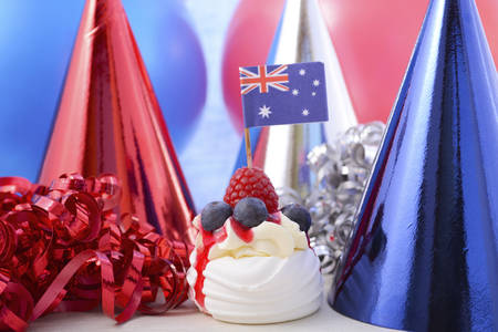 Happy Australia Day Party in red, white and blue theme with mini pavlova and party decorations. Stock Photo