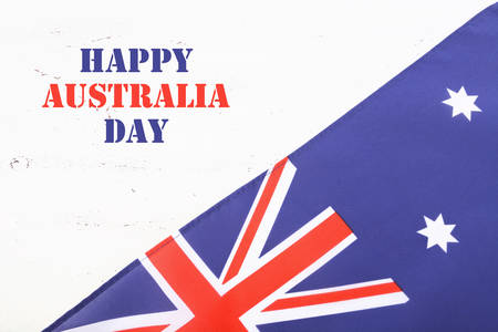 downunder: Australian flag on white shabby chic wood background with sample text greeting.