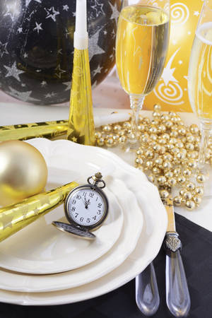 12 o clock: Happy New Year black, gold and white dinner party table place setting. Stock Photo