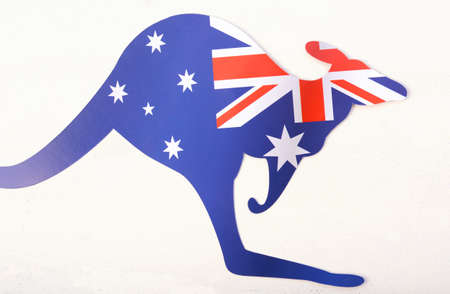 above 25: Australian flag in the shape of a kangaroo on white wood shabby chic table.