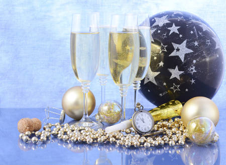 12 o clock: Happy New Year party celebration with ballon, champagne glasses, decorations and pocket fob watch at nearly midnight, closeup on champagne bottle cork.