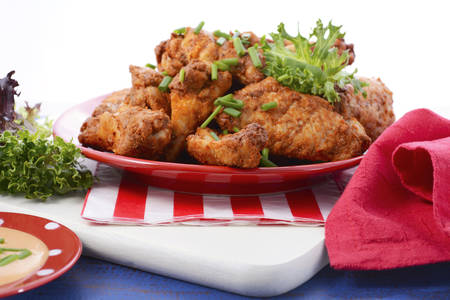 football party: BBQ setting with spicy chicken wings with red, white and blue color theme.