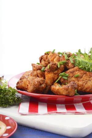 fried food: BBQ setting with spicy chicken wings with red, white and blue color theme.