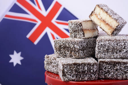 anzac: Traditional Australian Lamington Cakes with Australian flag on red white and blue theme colours.