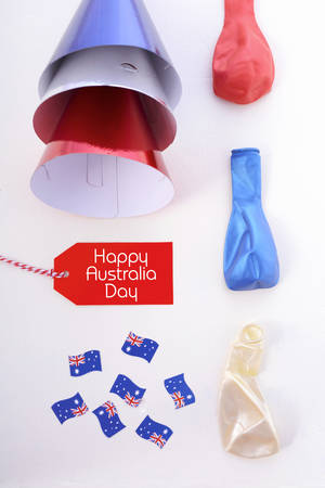 above 25: Australia Day party decorations in red, white and blue theme on a white wood table. Stock Photo