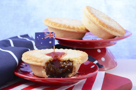 tucker: Traditional Australian Meat Pies for Australia or Anzac Day holiday party food, in red, white and blue setting.