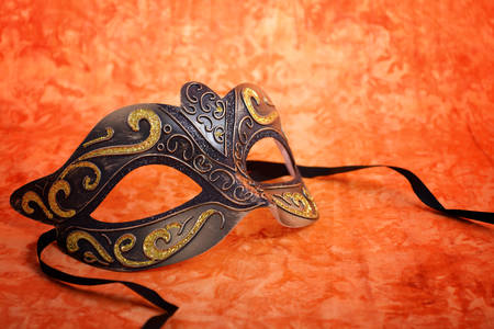 mardi gras mask: Mardi Gras mask on a bright, colorful orange background, closeup.