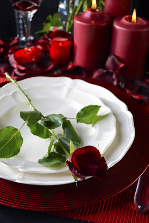 Romantic candle light Valentine Table Setting for two with red roses gift and burning candles & Romantic Valentine Candle Light Dinner Table Setting With Red ...