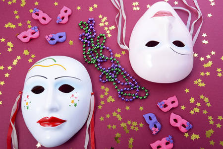 new year eve beads: Mardi Gras masks with party decorations, beads and glitte stars.