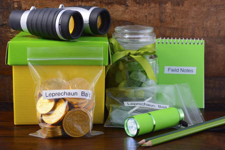 st  paddy's day: St Patricks Day Catch a Leprechaun Kit gift with binoculars, torch, field notes notepad, pencils, and candy and coins leprechaun bait bags.