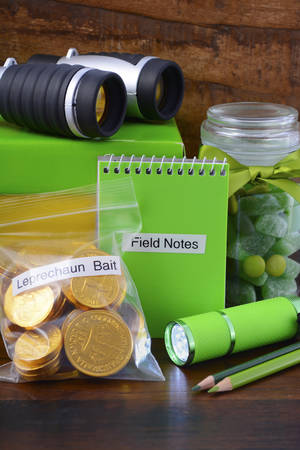 paddys day: St Patricks Day Catch a Leprechaun Kit gift with binoculars, torch, field notes notepad, pencils, and candy and coins leprechaun bait bags.